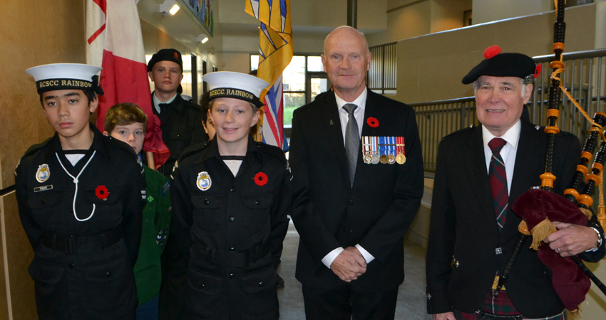 The Honour Guard prepares to enter our Remembrance Day Assembly