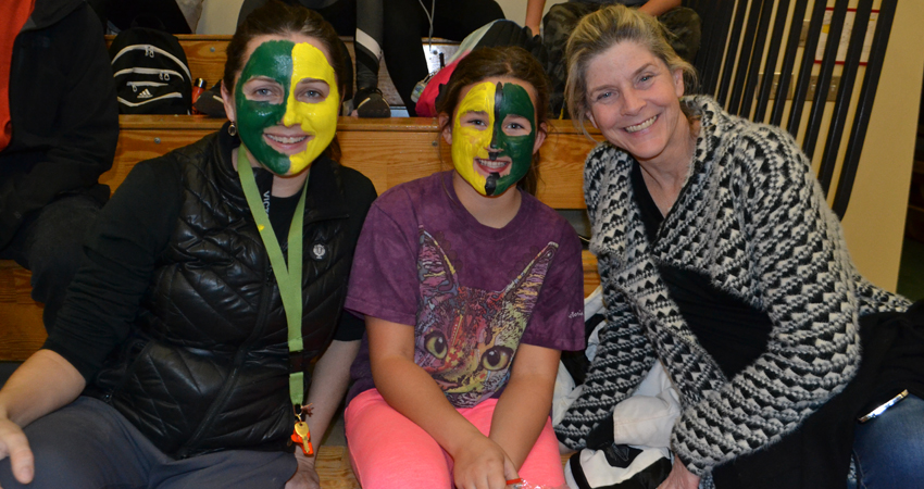 """""""Face Painters Unite!"""" to cheer on the grade 6 boys' basketball team"""
