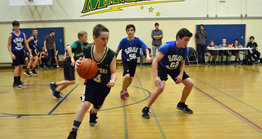 Takin' it to the rack on the Senior Boys' basketball team.